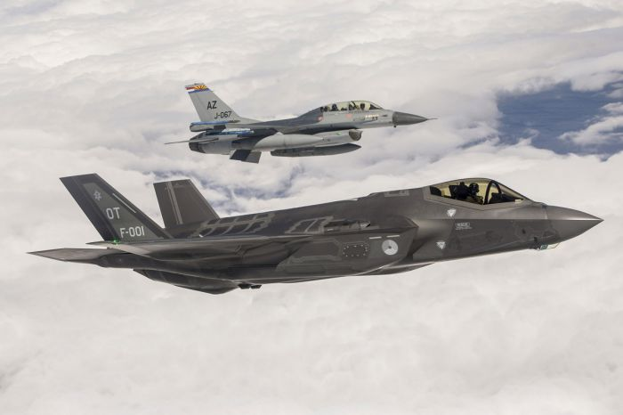 Dutch F-35A in front of the airplane type it will replace (F-16)